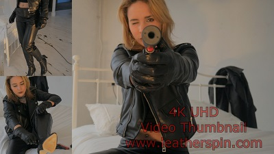 girl-with-gun-leather-gloves-leather-pants-leather-jacket