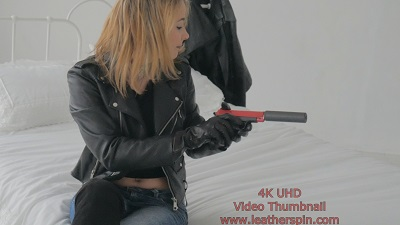 Girl-in-leather-gloves-with-gun-leather-jacket-overknee-leather-boots