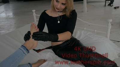 Girl-in-leather-pants-with-leather-gloves-foot-massage-cute