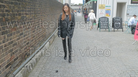 Chinese-Girl-in-leather-gloves-leather-jacket-overknee-leather-boots