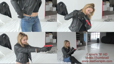 girl-in-leather-boots-with-leather-gloves-and-leather-jacket-gun