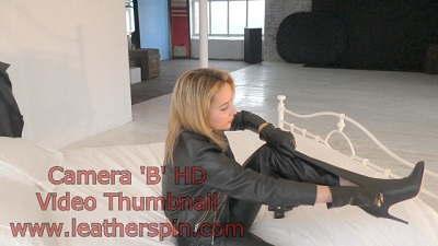 girl-in-leather-pants-leather-boots-with-leather-gloves-and-leather-jacket-gun.jpg