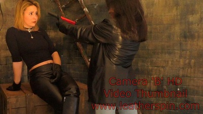 girl-with-gun-in-leather-boots-pants-overknee-leather-gloves