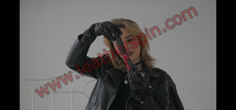 Girl with gun leather gloves leather pants boots