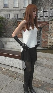 Girl-leather-gloves-wearing-leather-boots-and-jacket