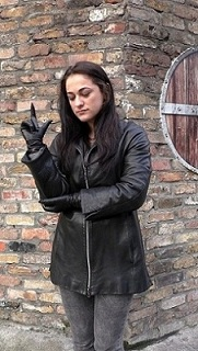 Girl-leather-gloves-wearing-leather-boots